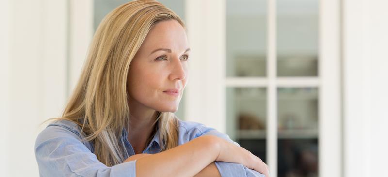 mature woman thinking about finances